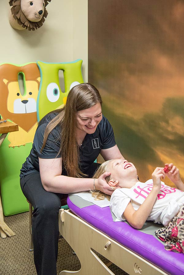 Dr Nicole working with a child